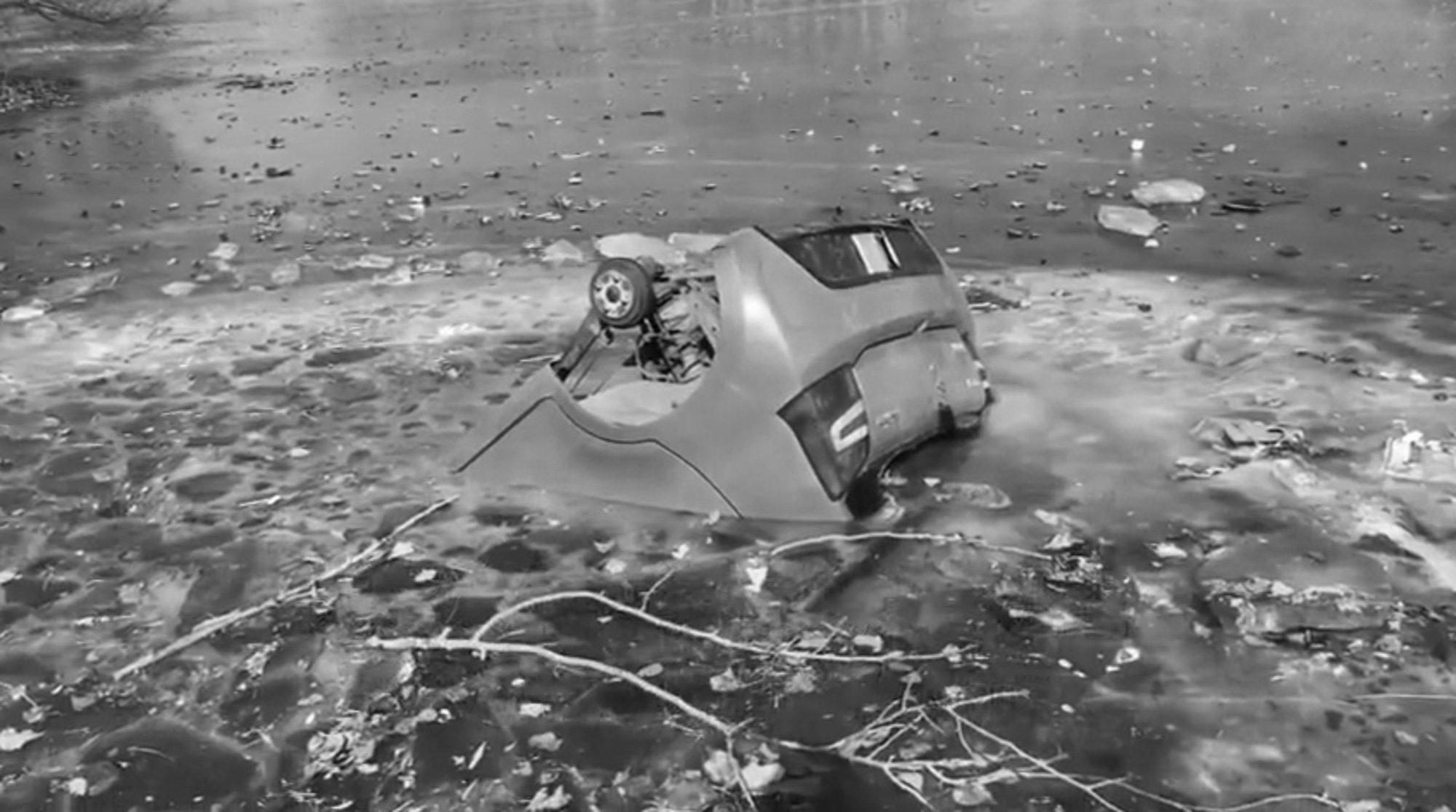 Car Frozen Solid In River Has Wheels Stolen