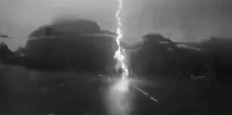 Lucky Moped Rider Avoids Lightning Striking Road