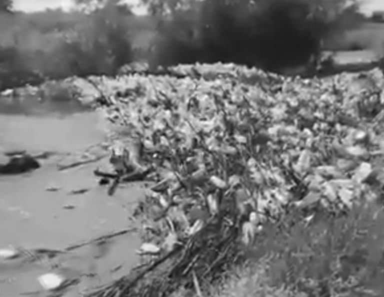 Huge Pile Of Plastic Clogs Up Idyllic Countryside River