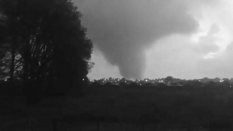 Tornado Twists Through City Sending Debris Flying