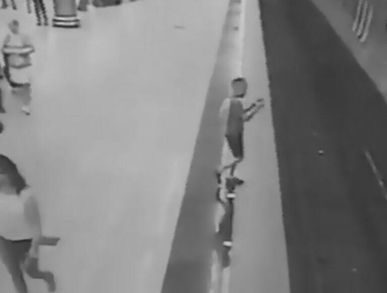 Boy Engrossed In Phone Game Walks Onto Live Rail Tracks