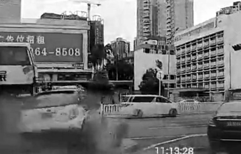 Out-Of-Control Taxi Crashes Into Junction