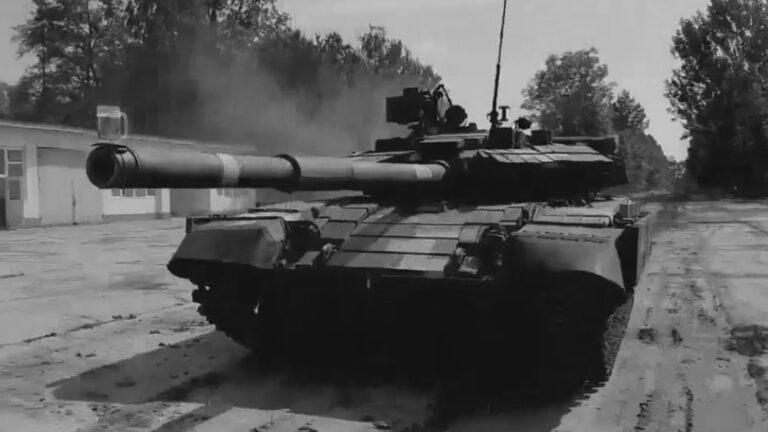 Ukraine Tank Drives Over Rough Terrain With Beer On Gun